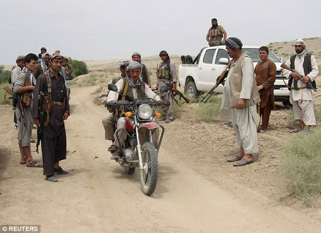 Courtesy: www.dailymail.co.uk, Officials said that Taliban gunmen had surrounded a police station in southern Uruzgan province yesterday and were holding 70 police officers hostage.