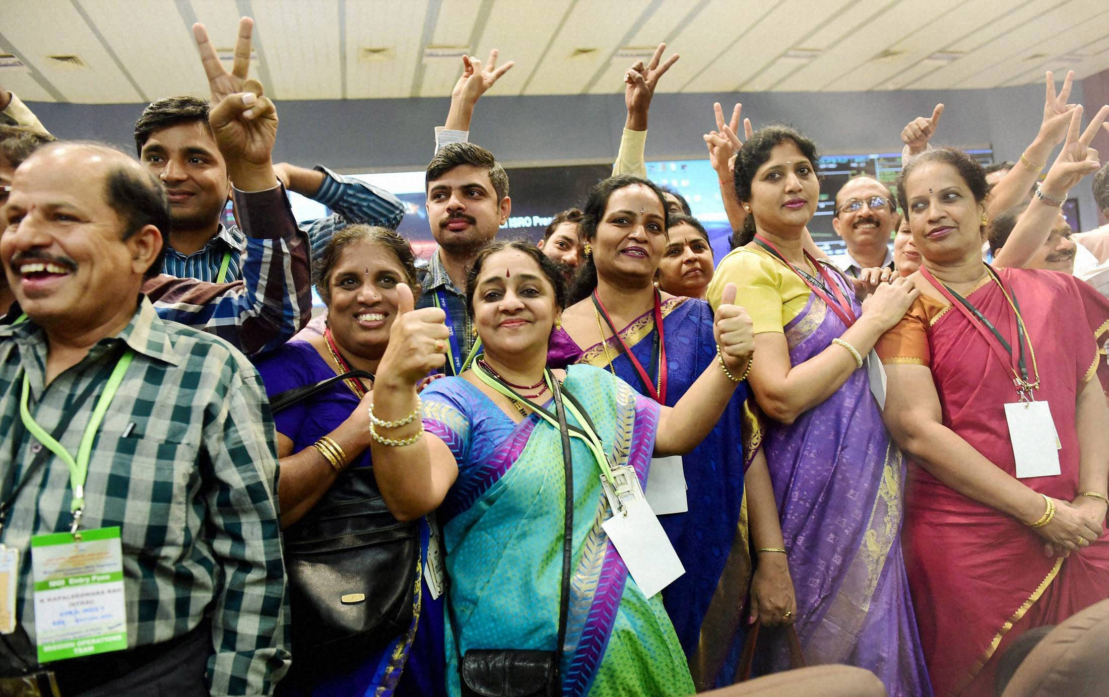 Bengaluru: ISRO scientists and other officials celebrate the success of Mars Orbiter Mission at MARS Orbiter Command Network complex in Bengaluru on Wednesday. PTI Photo by Shailendra Bhojak (PTI9_24_2014_000055B)